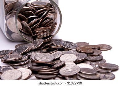 US coins spilling from a money jar.