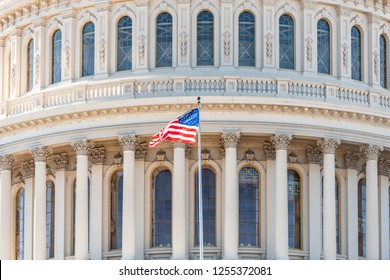 US Congress dome closeup with American flag waving in Washington DC, USA on Capital capitol hill, columns, pillars, nobody