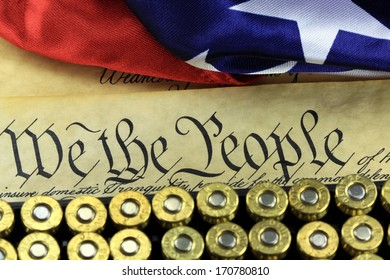 US Constitution Bill of Rights with 45 caliber bullets and American flag