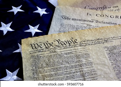 US Constitution with Bill of Rights and Declaration of Independence on an American Flag