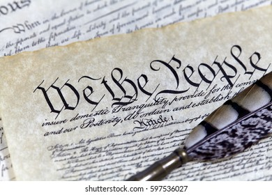 US Constitution, Declaration of Independence, Bill of Rights with a Quill pen and shallow depth of field