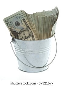 US Currency Twenty Dollar Bills in Silver pail or a metal Bucket,  isolated on white background.
