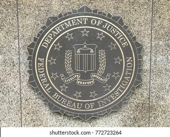 U.S. Department of Justice/FBI Emblem on the Outside Entrance wall of The FBI Building in Washington, D.C.  Shot on November 24, 2017.