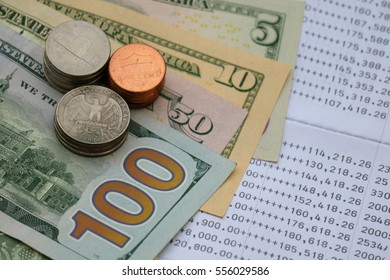 U.S. dollar banknote and coin on bank statement, investment saving concept
