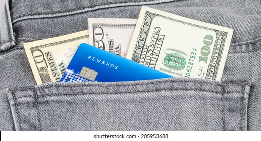 US dollar banknote and credit card in the grey jean pocket