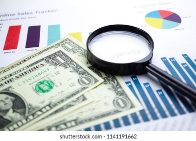US dollar banknotes money on chart graph spreadsheet paper. Financial development, Banking Account, Statistics, Investment Analytic research data economy, trading, office reporting Business concept.