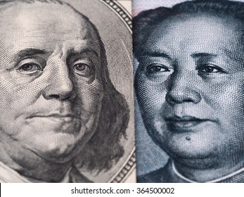 US dollar bill (Ben Franklin) and Chinese yuan banknote (Mao Zedong) close up macro, united states and China money closeup