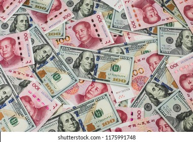 US dollar bill and Chinese yuan banknote. USD vs RMB.