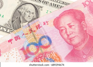 US dollar bill and Chinese yuan banknote on white background, USA and Chinese exchange rate concept.