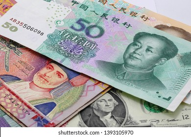 US dollar bill Oman rial and China yuan banknote, Chinese, Oman  and USA economy finance trade business,  forex, money.