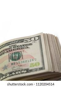 US Dollar bills on white background