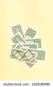 US Dollar Bills On yellow Background