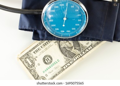 US dollar in a blood pressure monitor, currency treatment concept