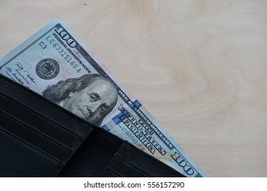 US Dollar cash banknote in wallet