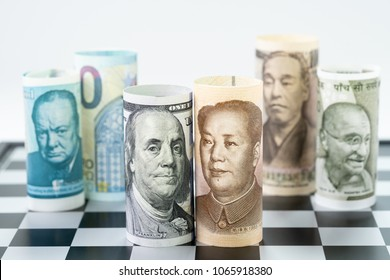 US Dollar and China bank roll at front surrund with world major countries, india, japan, europe and uk on chessboard, US and China trade war, global financial economy concept.