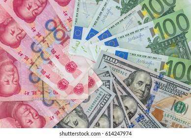 US dollar and Euro, yuan  banknotes as background