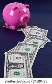 US dollar money trail leading to a pink piggy bank