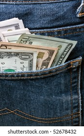 US Dollar notes in a blue jeans.