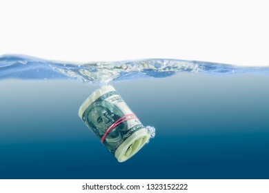 US Dollar sinking in water as symbol of global financiall crisis
