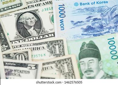 US Dollar and South Korea Won Banknotes close up image.