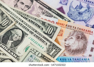 US Dollar and Tanzania Shilling currency banknotes. USA Dollar Tanzania Shilling Africa Money
