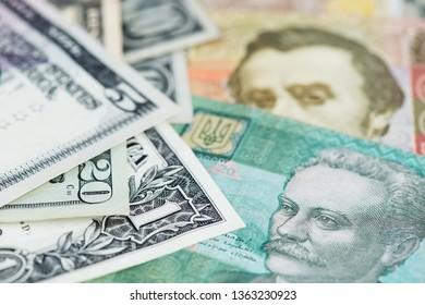 US Dollar and Ukraine Hryvnia currency. US Dollar bill and Ukrainian Hryvnia banknotes close up image. Ukraine money Hryvnia