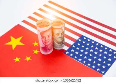 US dollar and Yuan banknote on USA and China flags. Its is symbol for tariff trade war crisis between biggest economic country in the world.