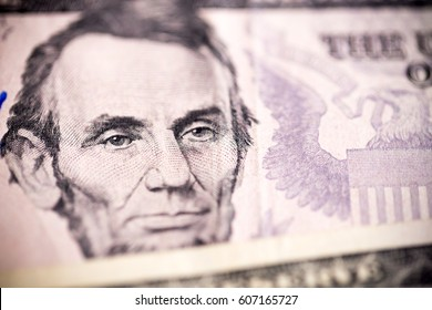 US dollars $5 dollar bill note with the face of president Abraham Lincoln.