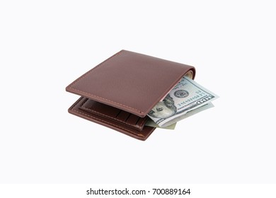 US dollars in a brown leather wallet isolated on white background.