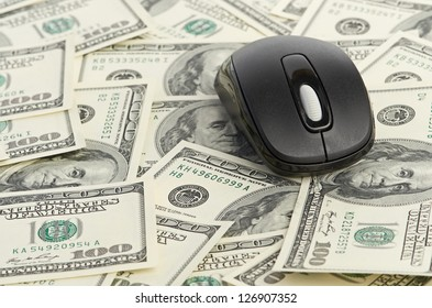US Dollars and Computer Mouse