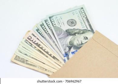 US dollars in envelope on white background, Bonus concept.
