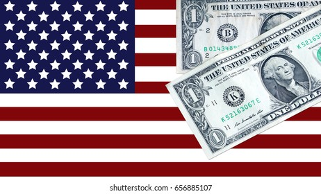 US Dollars on the flag of United states background. Economy and business.