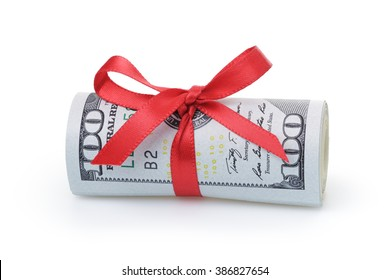 us dollars rolled and tied with red ribbon, isolated on white
