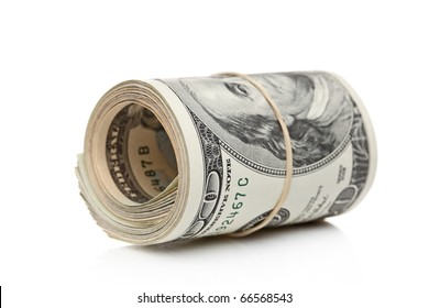 US dollars rolled up and tightened with band isolated on white background