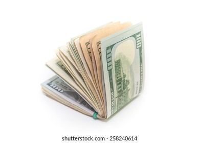 US Dollars tied with a rubber band isolated, white background