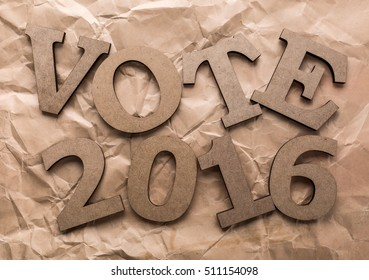 "US Election 2016 theme. Phrase ""VOTE 2016"" on rough the packaging paper banner be composed volumetric letters."