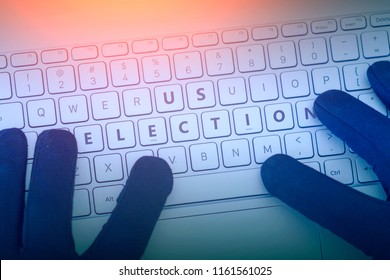US ELECTIONS inscription on laptop keyboard. Hacker man using a laptop attacks the web. Cyberattack, issues with modern elections, the hacking of accounts and leaking of information