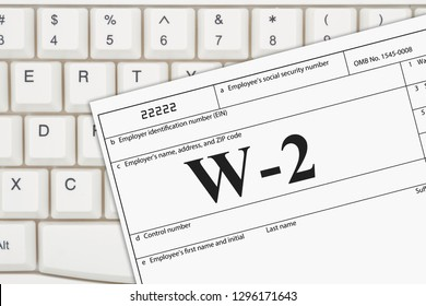 A US Federal tax W2 income tax form on a keyboard