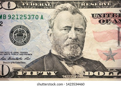 A U.S. fifty 50 Dollar Bill close up of Ulysses S. Grant. Highly detailed picture of American money. Portrait of Ulysses S. Grant on the fifty dollar banknote.