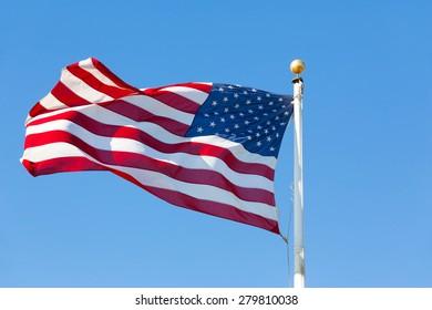 US flag against blue sky