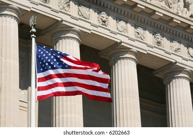 US flag against Washington buildings