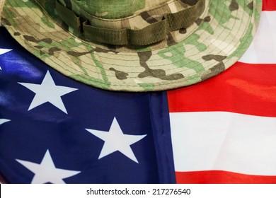 US flag with camouflage cap combat hat