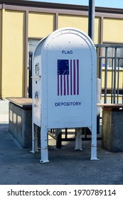 U.S. Flag depository sign on box used for that collects worn U.S. flags to retire them with honor. - Sacramento, California, USA - 2021