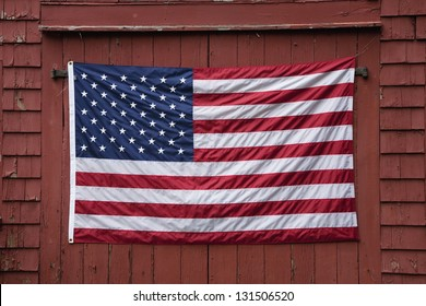 US Flag displayed on red barn door on Memorial Day, 2011, outside of Lexington, MA