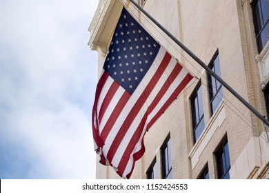 US flag displayed from traditional Los Angeles downtown city building.