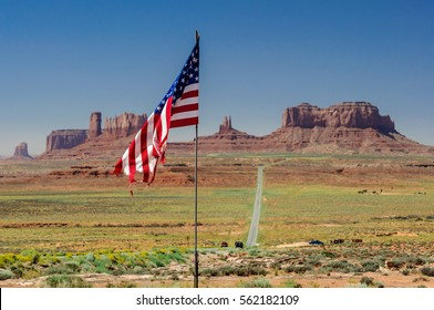 US Flag in front of front of Monument Valley, Utah, USA