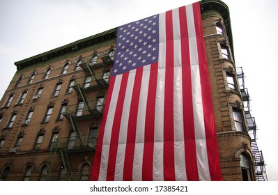U.S. flag hung from an apartment building in downtown New York City