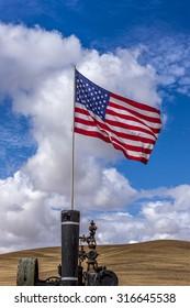 US flag on a steam engine at the Colfax Threshing Bee in Colfax, Washington.