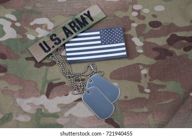US flag patch with dog tag on multicam camouflage uniform