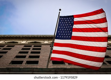 A US flag as seen from the street as it hangs from a building in Philadelphia, PA.